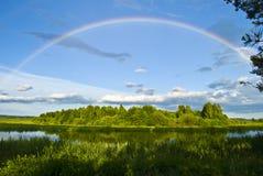 Rainbow landscape. Rainbow over the lake landscape Stock Photos