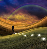 Rainbow landscape and man Royalty Free Stock Images