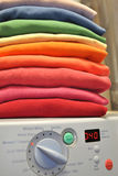 Rainbow laundry on washing machine Royalty Free Stock Photography