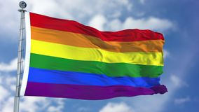 Rainbow Waving Flag. Rainbow lgbt gay pride flag waving against clear blue sky, close up,  with clipping path mask luma channel, perfect for film, news Royalty Free Stock Photos