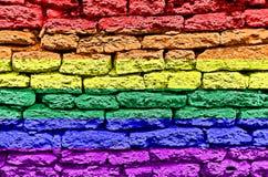 Rainbow Flag. Over brick wall stock photos