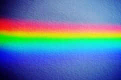 Rainbow light on concrete yellow wall background Stock Images