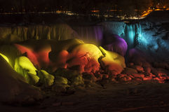 Rainbow Light on Frozen Falls. The American Falls with a rainbow of light on them, frozen over in wintertime, Niagara Falls, NY royalty free stock photos