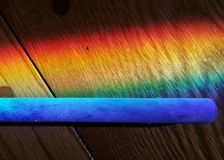 Rainbow Light on Hardwood and Glowing Blue Pipe Stock Image