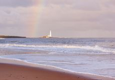 Rainbow and Lighthouse Stock Images