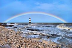 Rainbow lighthouse Stock Images