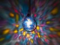 Rainbow Lights on the Wall 2. Rainbow wall sconce creating blurred rainbow colors on a blank wall Royalty Free Stock Photo