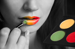 Rainbow lips. Brush painting rainbow lips. Black and white, parlty color Royalty Free Stock Photography