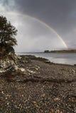 Rainbow on Loch Eishort on the Isle of Skye. Rainbow and castle ruins on Loch Eishort on the Isle of Skye in Scotland Royalty Free Stock Image