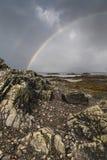 Rainbow on Loch Eishort on the Isle of Skye. Rainbow and rock on Loch Eishort on the Isle of Skye in Scotland stock photography