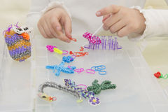Rainbow loom- Colored rubber bands for weaving accessories Stock Photos