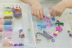 Rainbow loom- Colored rubber bands for weaving accessories Stock Images