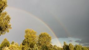 Rainbow after a lot of rain in the Valdai region. stock photography