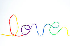 Rainbow love lettering with yarn. Isolated rainbow love lettering from yarn Stock Images