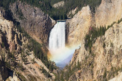 Rainbow at the Lower Falls of the Yellowstone river. Wyoming, USA Stock Images