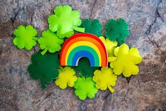 Rainbow and Lucky shamrocks, concept for St Patricks Day in March. Flatlay on marble background.  stock image