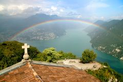 Rainbow on Lugano Lake. A view of Lugano Lake, Switzerland, from the top of San Salvatore, with a full rainbow Royalty Free Stock Photography
