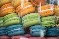 Rainbow macaroons in a jar stock image