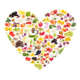 Rainbow made from different fruits and vegetables in the shape of the heart royalty free stock image