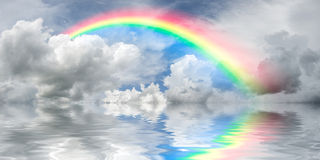 Rainbow and majestic clouds Royalty Free Stock Images