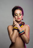 Rainbow make-up. Portrait of a young attractive woman with bright make-up Royalty Free Stock Photography
