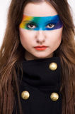 Rainbow Makeup. Portrait of a beautiful woman with Beautiful Eye rainbow Makeup Royalty Free Stock Image