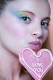 Rainbow makeup and heart lollipop Stock Photo