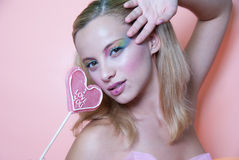 Rainbow makeup and heart lollipop Royalty Free Stock Photo