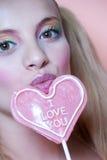 Rainbow makeup and heart lollipop Stock Image