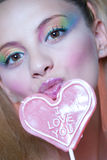 Rainbow makeup and heart lollipop Stock Images