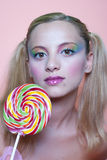 Rainbow makeup and swirl lollipop Royalty Free Stock Images