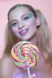 Rainbow makeup and swirl lollipop Stock Photos