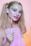 Rainbow makeup and swirl lollipop Royalty Free Stock Photo