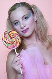 Rainbow makeup and swirl lollipop Stock Image