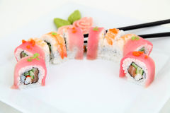 Rainbow Maki Sushi with Eel, Tuna, Salmon and Avocado Royalty Free Stock Photography