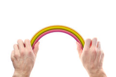 Rainbow in male hands. Rainbow in the men's hands on a white background stock image