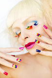 Rainbow manicure and makeup. stock photography