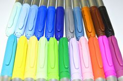 Rainbow marker pens. A large collection of brightly colored felt tipped pens royalty free stock image