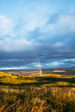 Rainbow and Massive Clouds at Sunrise Royalty Free Stock Photography