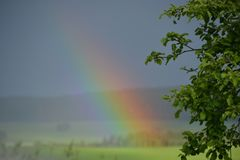 The Rainbow on a meadow and sun day Stock Images
