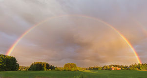 Rainbow on meadow Royalty Free Stock Photo