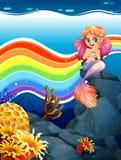 Rainbow and mermaid Stock Photos
