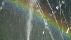 Rainbow in the Fountain. A rainbow is a meteorological phenomenon that is caused by reflection, refraction and dispersion of light in water droplets resulting stock video