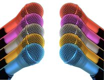 Rainbow Mics. Multicolored microphones lined up facing each other royalty free stock image
