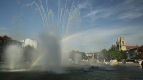 Fountain in Republic Square. Rainbow in the middle of fountain at Medieval Republic Square or Praca da Republica known as Arcade. Braga urban cityscape, one of stock footage
