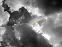 Rainbow middle heap gray cloud black white color Stock Photo