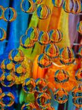 Rainbow in minerals and details. Plastic fluid tasty mass, turquoise, gold, orange, red, bluenn stock image