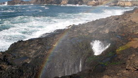 Rainbow In Mist From Spout Horn Newport Oregon. Rainbow From Mist Of Waves Spouting Out Of Lava Rocks Newport Oregon stock footage
