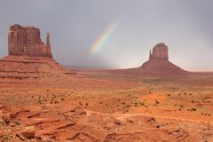 Rainbow and Mittens - Monument Valley, Arizona Royalty Free Stock Image