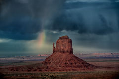 Rainbow Monument. Rainbow in Monument Valley after a storm Stock Photos
